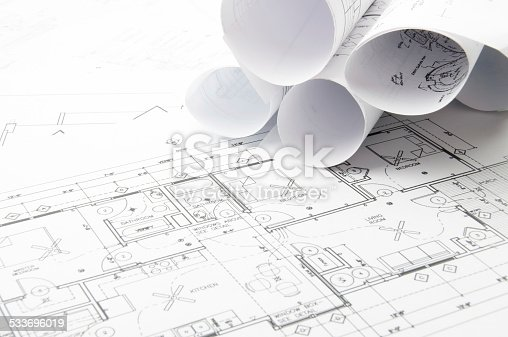 508818208 istock photo Architectural blueprints and blueprint rolls with drawing instruments 533696019