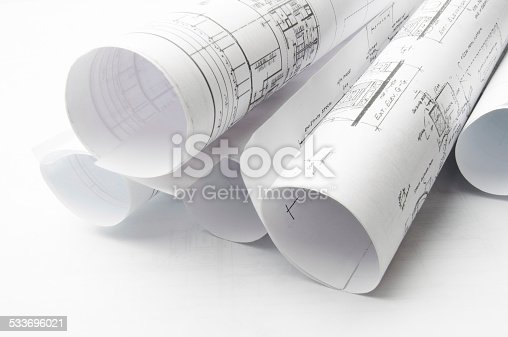 479196874 istock photo Architectural blueprints and blueprint rolls with drawing instruments 533696021