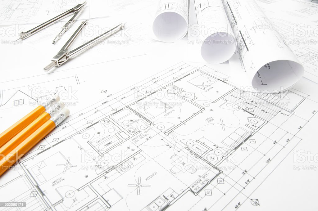 Architectural blueprints and blueprint rolls with drawing architectural blueprints and blueprint rolls with drawing instruments royalty free stock photo malvernweather Images