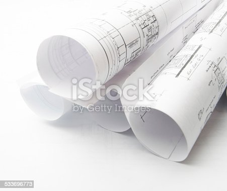 508818208 istock photo Architectural blueprints and blueprint rolls with drawing instruments 533696773