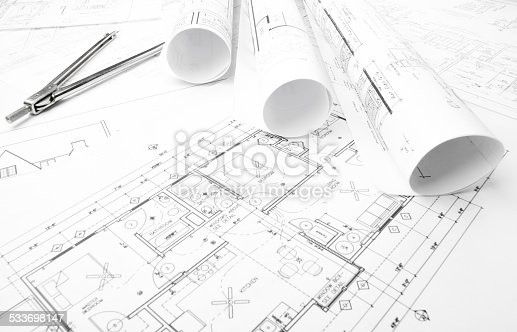 508818208 istock photo Architectural blueprints and blueprint rolls with drawing instruments 533698147
