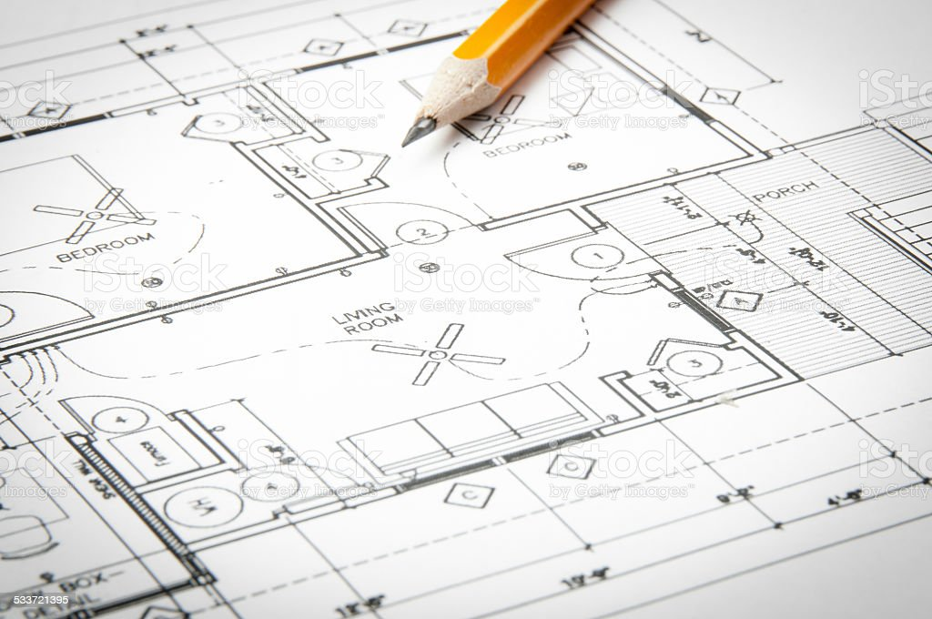 Architectural Blueprints And Blueprint Rolls With Drawing Instruments  Royalty Free Stock Photo