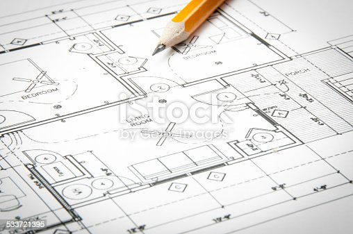 508818208 istock photo Architectural blueprints and blueprint rolls with drawing instruments 533721395