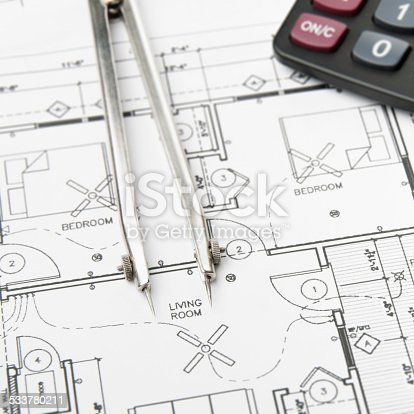 508818208 istock photo Architectural blueprints and blueprint rolls with drawing instruments 533780211
