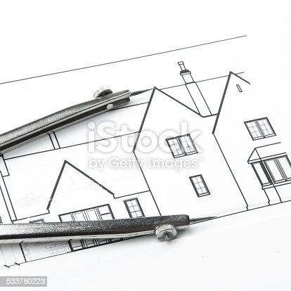 508818208 istock photo Architectural blueprints and blueprint rolls with drawing instruments 533780223