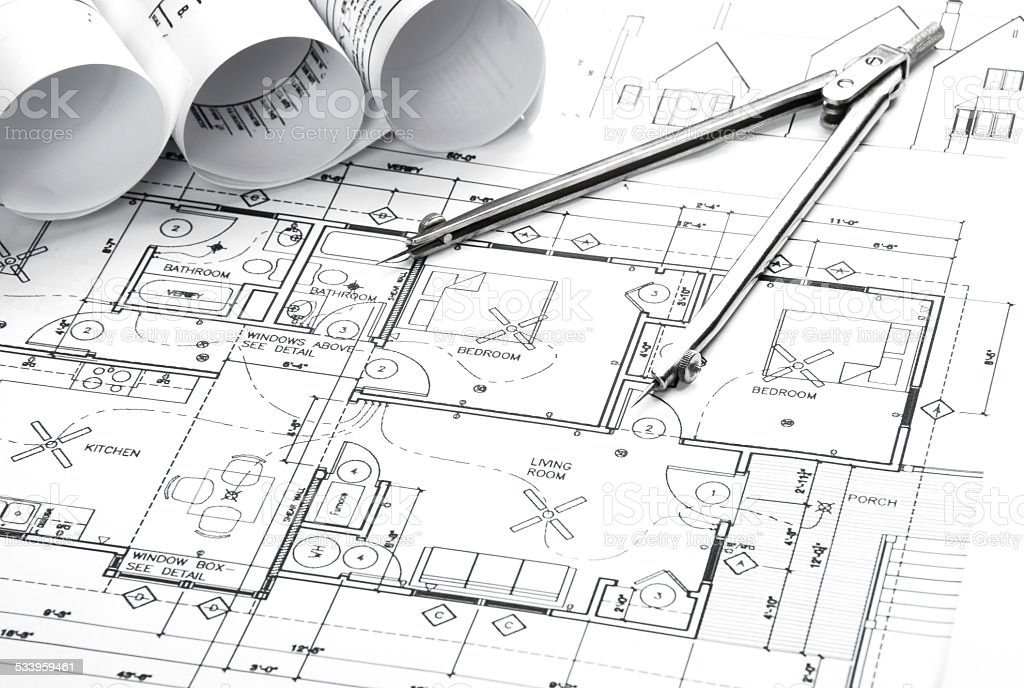 Architectural blueprints and blueprint rolls with drawing architectural blueprints and blueprint rolls with drawing instruments royalty free stock photo malvernweather Image collections