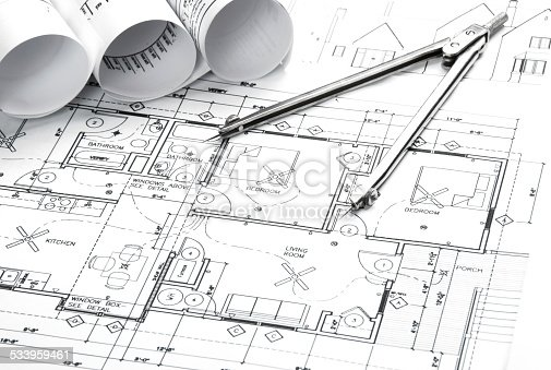 508818208 istock photo Architectural blueprints and blueprint rolls with drawing instruments 533959461