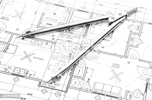 508818208 istock photo Architectural blueprints and blueprint rolls with drawing instruments 533959469