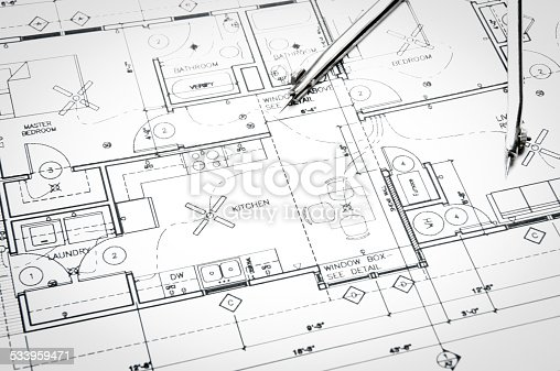 508818208 istock photo Architectural blueprints and blueprint rolls with drawing instruments 533959471