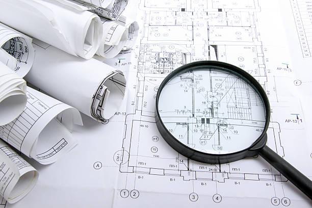 Architectural blueprint programas y rollos con lupa - foto de stock