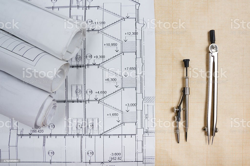 Architectural blueprints, blueprint rolls, compass divider, calc stock photo
