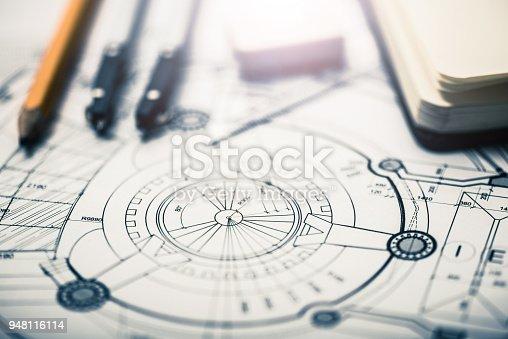 istock Architectural blueprints on architect's desk 948116114