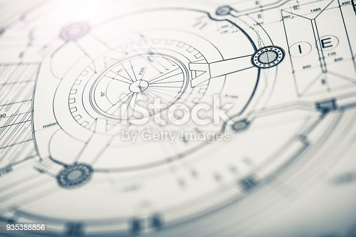 Background image showing architectural drawings, shallow depth of field