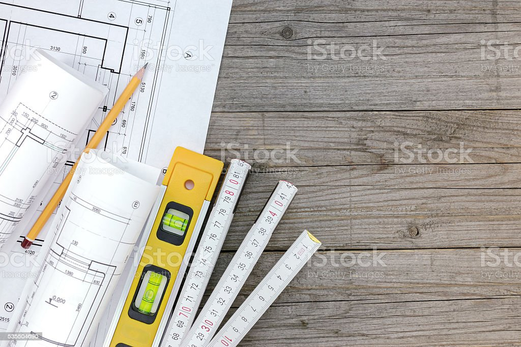 architectural blueprints with contractor work tools with floor plan stock photo