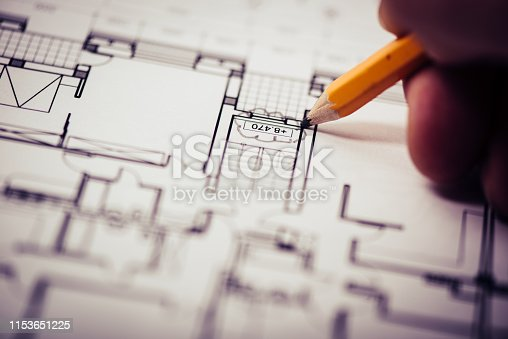 Hand drawn red revision cloud on architectural drawings