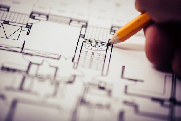 Architectural blueprints with red revision cloud stock photo