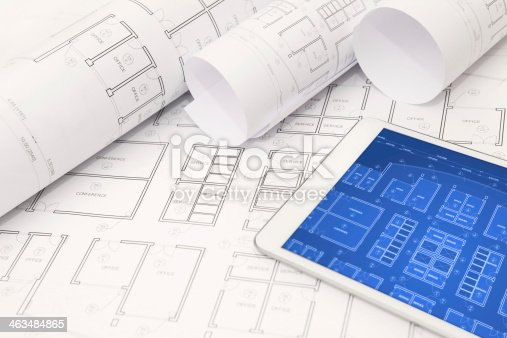 istock Architectural design project blueprints and documents with interactive tablet 463484865