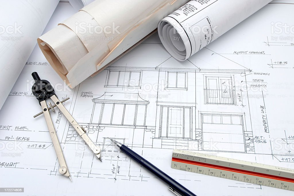 Architectural design tools and blueprints on a desk royalty-free stock photo