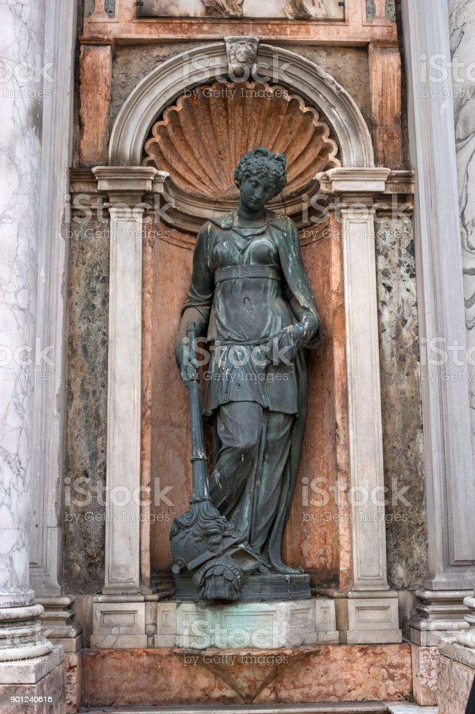 Architectural detail, a sculpture adorns the entrance to the Campanile di San Marco -bell tower of Saint Mark- Italy. stock photo