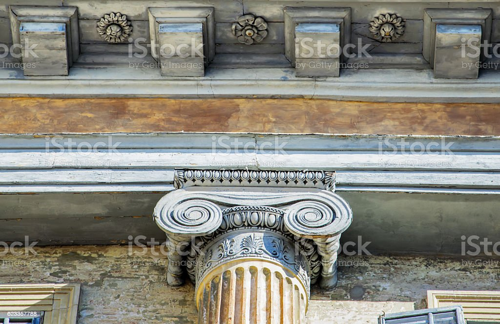Architectural detail of an ancient decorated capital. stock photo