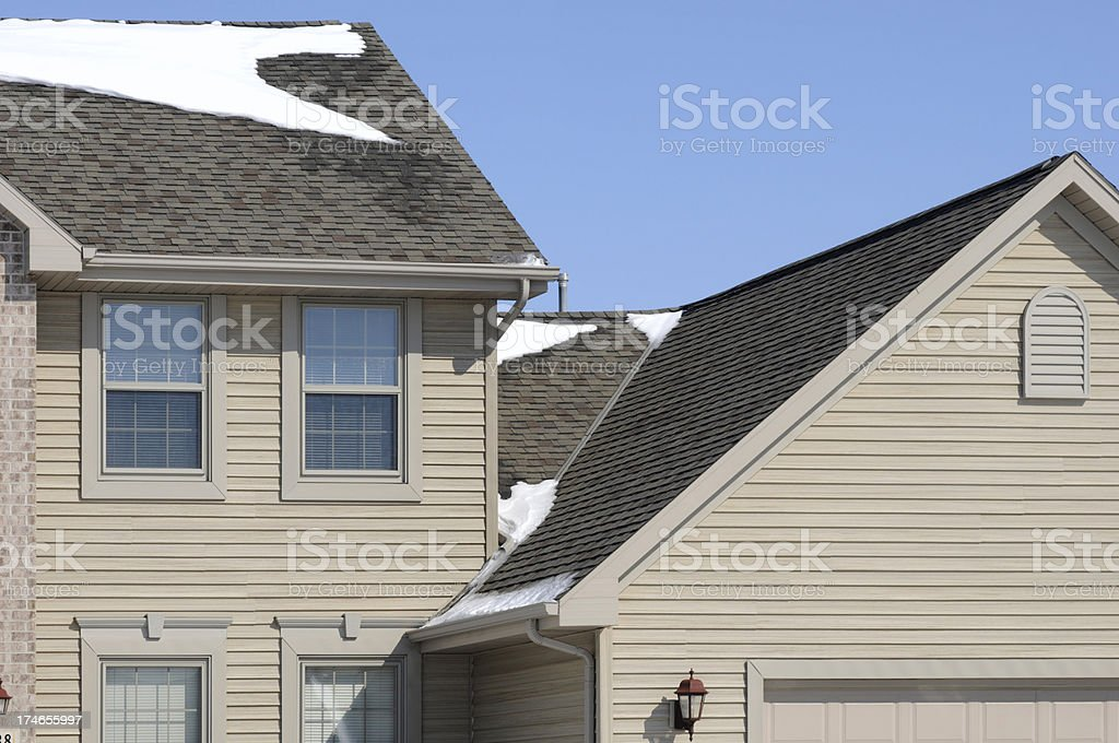 Architectural Detail of House; Winter, Snow, Gabled Roof, Vinyl Siding royalty-free stock photo