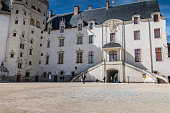 Nantes, France - September 25, 2018: architectural detail of the castle of the Dukes of Brittany on a summer day. It is classified as a historical monument since 1840