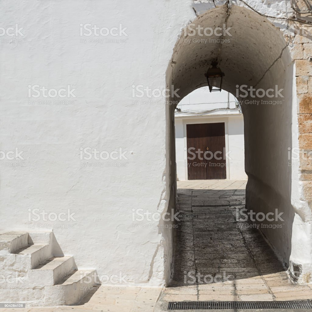 Architectural detail with stairs and arch at Cisternino (Italy) stock photo