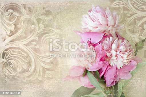 Architectural details. Antique wall in grunge style with meander, capitals, friezes. Art deco figures carved on stone as decoration on a facade building. Fragment of ornate relief with peony flowers.