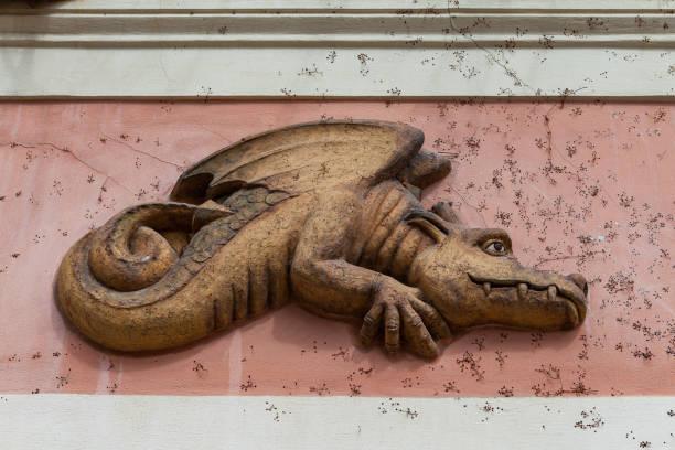 Architectural details decoration building facade. Funny dragon in Prague, Czech Republic. stock photo
