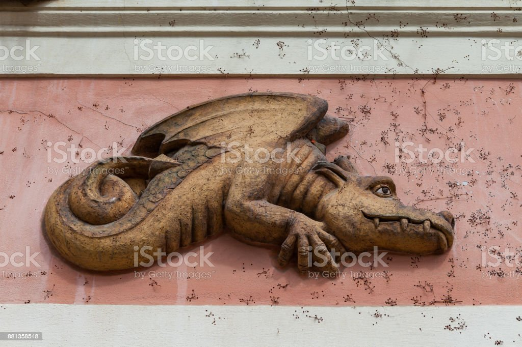 Architectural details decoration building facade. Funny dragon in Prague, Czech Republic. stock photo