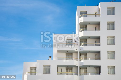 architectural details of a contemporary white building on sunny day