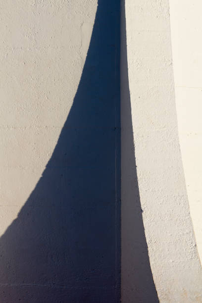 Architectural details of external lighthouse wall in shadow. stock photo