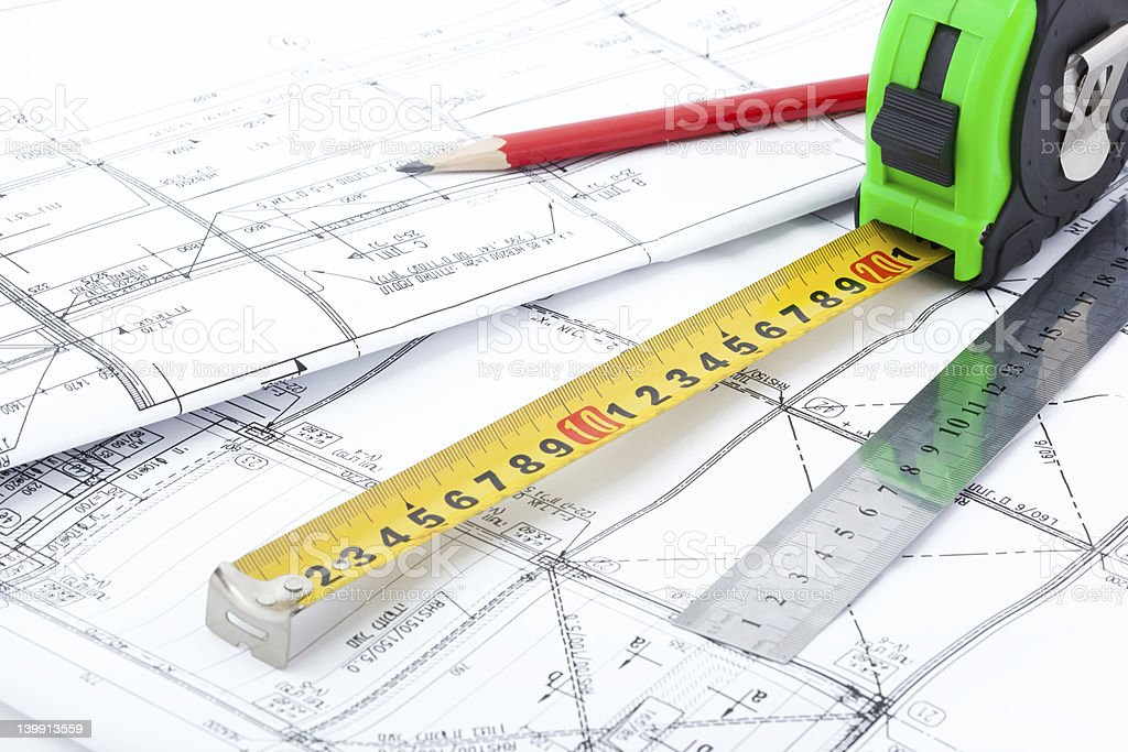 Architectural drawings and measurement tools royalty-free stock photo