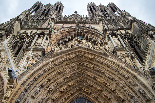 Architectural fragments of Notre-Dame de Reims cathedral facade stock photo
