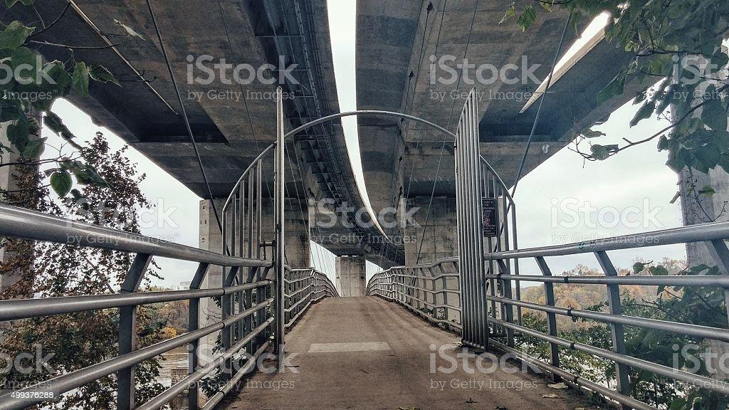 Architectural Gate Pedestrian Suspension Bridge, Belle Isle, Richmond, Virginia stock photo