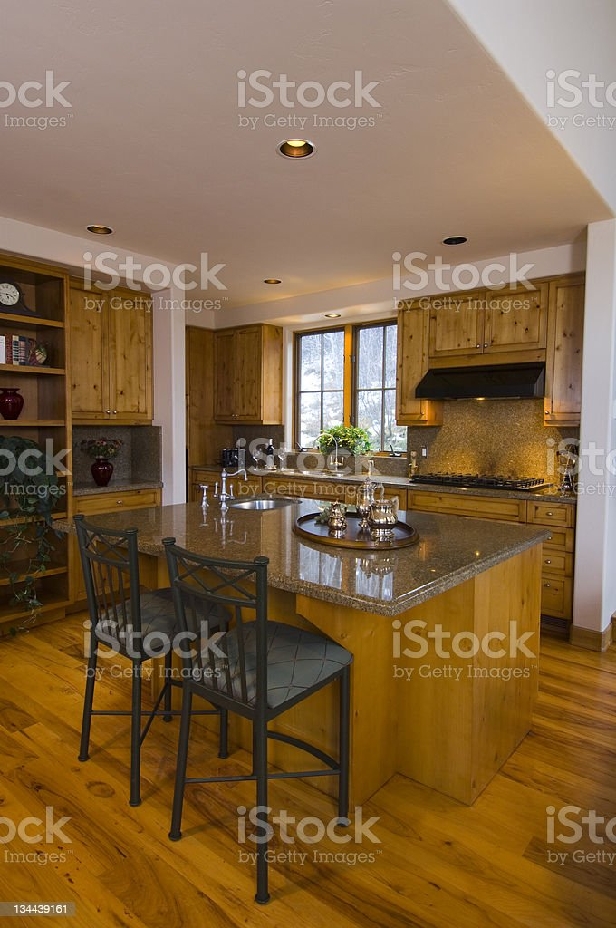 Architectural Home Kitchen Interior Vertical with Warm Tones royalty-free stock photo