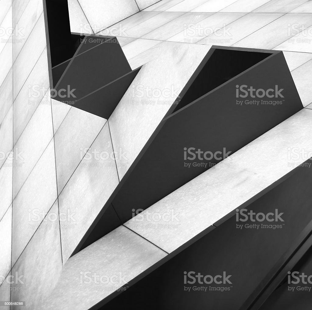Architectural image of sloped interior with shelving system stock photo