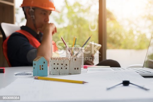 832105172 istock photo Architectural Office desk background construction project ideas concept, With drawing equipment and engineering using laptop 950688354