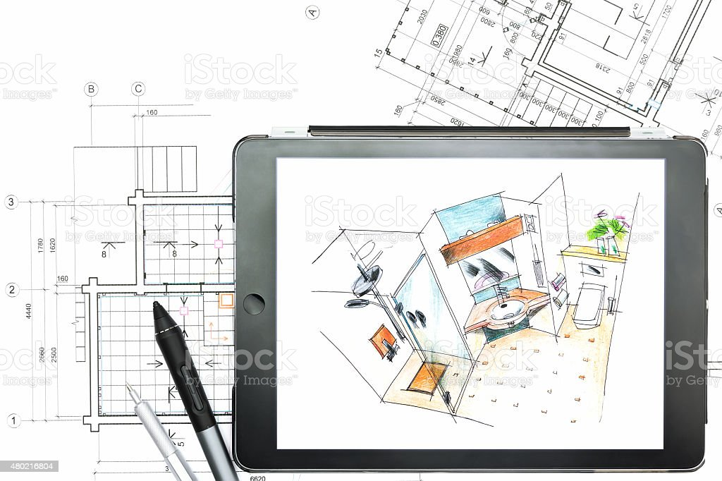 architectural plans with tablet computer stock photo