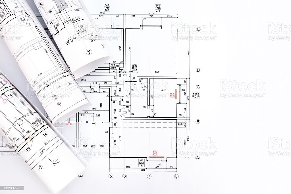 Architectural project blueprint rolls on plan stock photo more architectural project blueprint rolls on plan royalty free stock photo malvernweather Choice Image