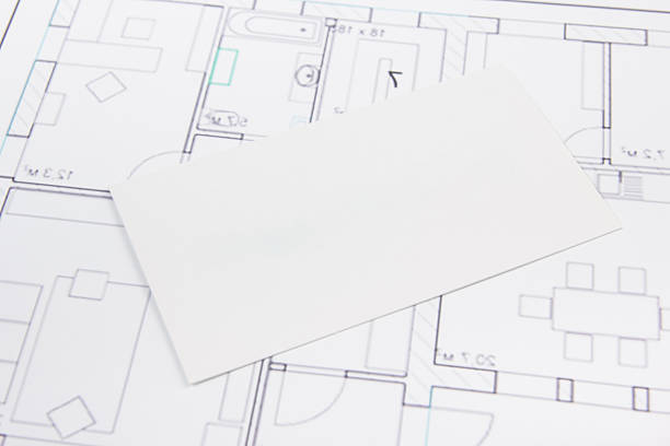 Architectural project, blueprints, key with house figure and blank business stock photo