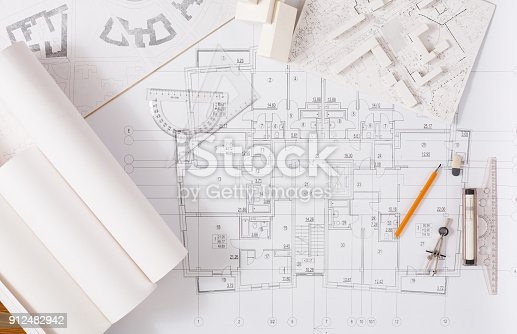 istock Architectural project, engineering tools on table. 912482942