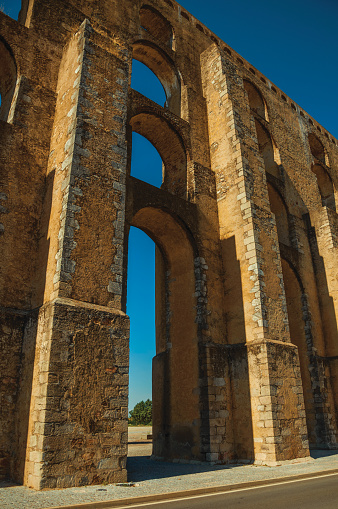 Architectural structure of the Amoreira Aqueduct with arches and rectangular pillars at Elvas. A gracious star-shaped fortress city in Portugal.