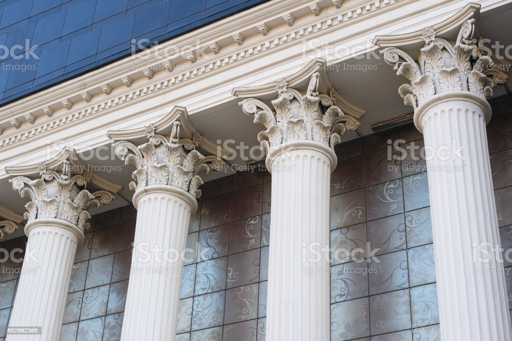 Architectural white Capital columns on the facade of the building stock photo