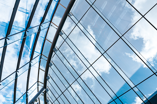 istock Architecture Abstract Modern Glass Roof and Blue Sky 931469936