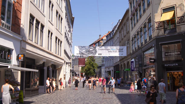 Architecture and buildings in the famous shopping street of Stroget in Copenhagen featuring the typical Scandinavian style stock photo