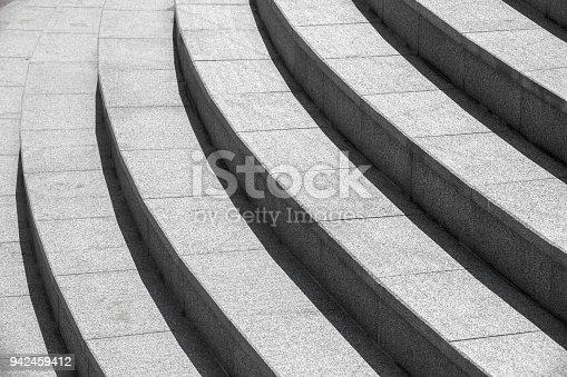 istock Architecture background, dark round stairs 942459412
