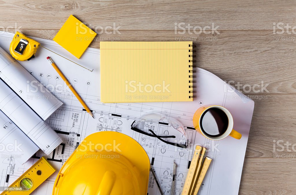Architecture concept Blueprints, Hardhat, Glasses, Stickers, Construction level, Pen and Coffee in architecture office 2015 Stock Photo