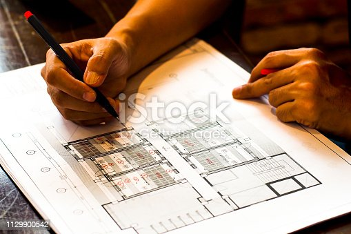 832105172 istock photo architecture construction drawing is aproved by architect for develop schemetic 1129900542