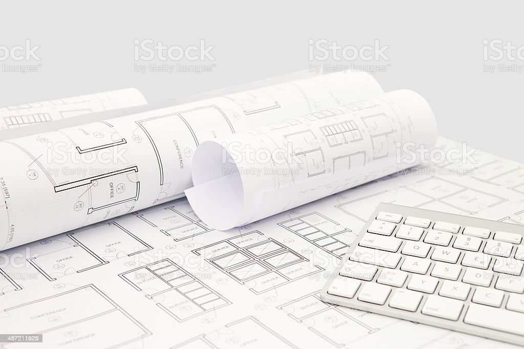 Architecture design project blueprints and computer keyboard architecture design project blueprints and computer keyboard background royalty free stock photo malvernweather Gallery